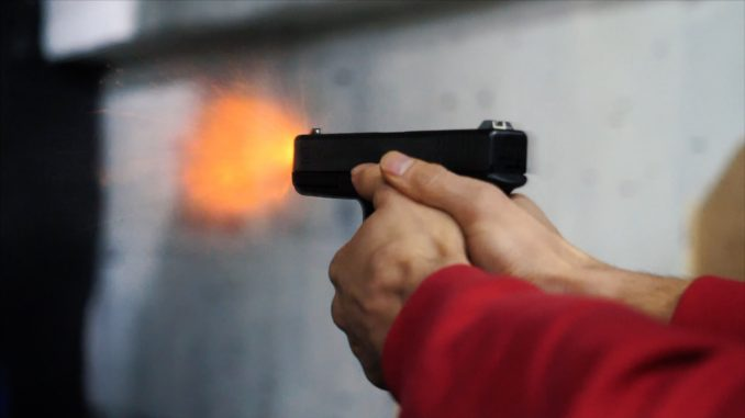 Pistol in hand close-up