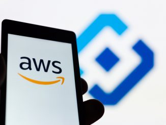 Smartphone in hand with Amazon Web Services AWS logo.