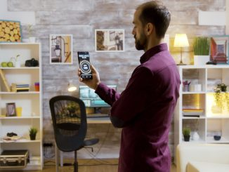Smart house application with a man turning on the lights using a voice command on his phone