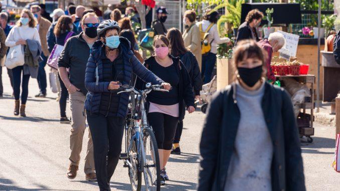Many people wearing Coronavirus face masks
