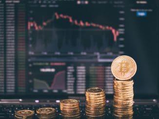 Photo Golden Bitcoins on forex chart background .