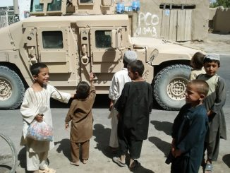 Group of seven children from Afghanistan asking for food from the US soldiers!