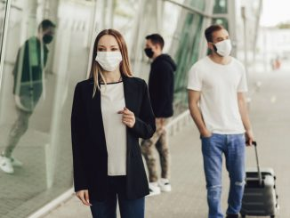 Figures of young people in protective masks near the airport. Safe travel during a pandemic. Airplane travel, quarantine and pandemic concept.
