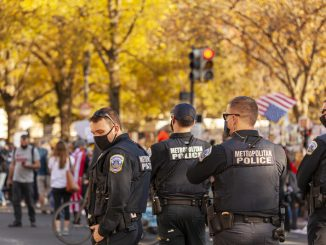 Metropolitan Police Officers form barricade to prevent tension while a crowd celebrates Joe Biden`s victory and protest President Trump after elections near White House