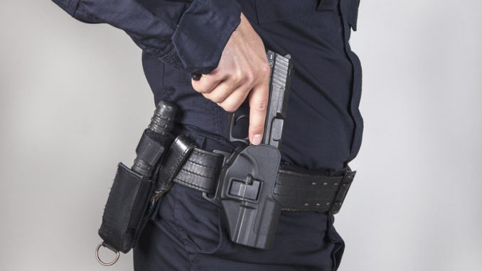 Policeman take off his gun from zone